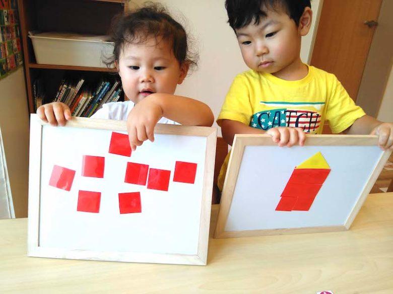 マグネット式で形遊びをしている子供達
